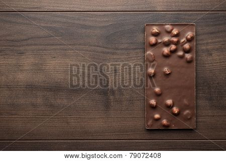 chocolate bar with whole hazelnuts