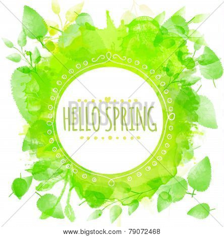 Hand drawn round frame text hello spring. Green watercolor splash texture with printed leaves. Artis