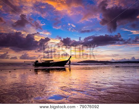 Long tail boat at Sunset on the beach of Ao Nang in Krabi Thailand