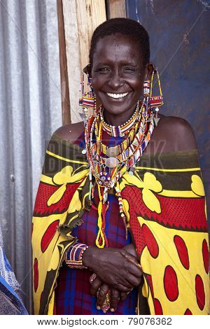 BISIL, KENYA-DECEMBER 7, 2010: Unidentified Maasai woman near the village of Bisil in southern Kenya wears traditional jewelry and tribal piercings
