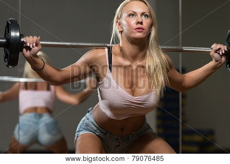 Sexy Woman Doing Exercise Barbell Squat