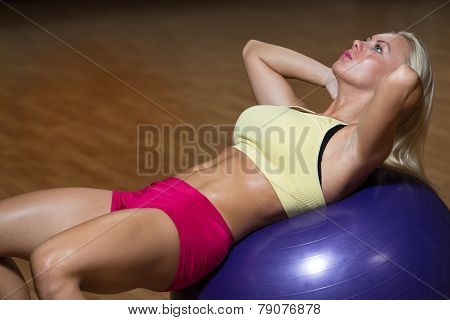 Young Female Doing Abs Workout