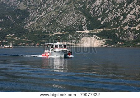 PERAST, MONTENEGRO - JUNE, 08: Taxi boat takes people for tours on the island of Our Lady of the Rocks, Perast, Montenegro, on June 08, 2012