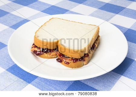 A delicious peanut butter and jelly sandwich with grape jam ready to be eaten during lunchtime.