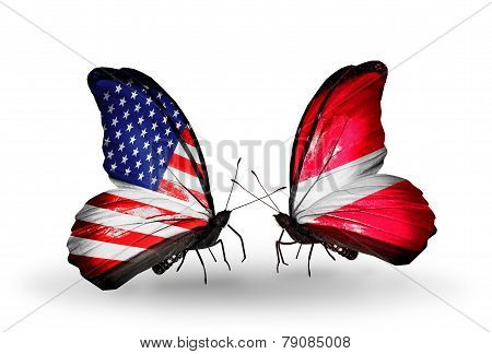 Two Butterflies With Flags On Wings As Symbol Of Relations Usa And Latvia