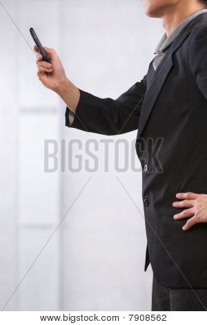 Young Semi Formal Businessman Using Cell Phone