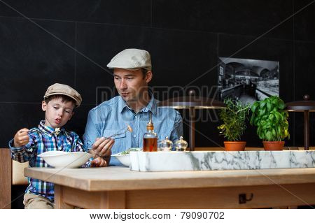 Father and son having lunch together