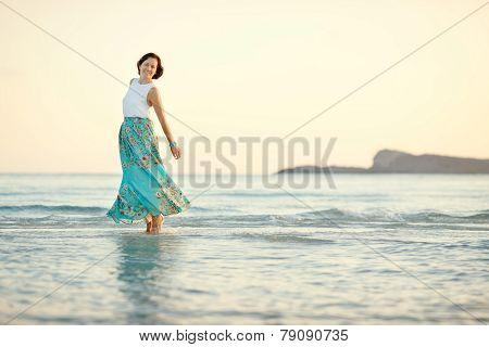 Young beautiful woman enjoying beach vacation