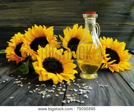 Sunflower oil with sunflower seeds and flowers