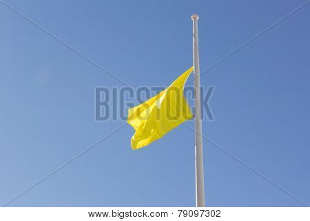 Yellow Flag At Half Mast