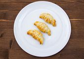 Постер, плакат: Savory croissants with sesame on wood from above
