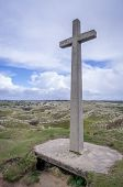 stock photo of cross hill  - Perran cross stunning hill near perranporth with blue clouds and fluffy clouds - JPG