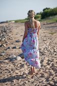 picture of minx  - Happy young woman with dreadlocks walking along the seashore - JPG