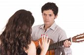 foto of serenade  - handsome young man with guitar serenading young girl isolated on white - JPG