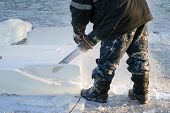 picture of man chainsaw  - man handles using chainsaws block of ice - JPG
