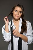 image of strip-tease  - Sexy young Caucasian brunette woman wearing men white shirt - JPG