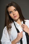 pic of strip-tease  - Sexy young Caucasian brunette woman wearing men white shirt - JPG
