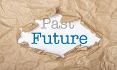 picture of past future  - Future and past words on white paper with copy space and torn cardbox - JPG