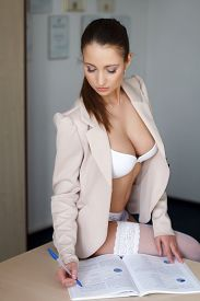 image of secretary  - Sexy secretary in underwear sitting on desk and write - JPG