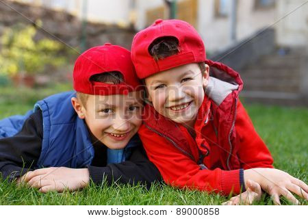 Little Boys Laughing In Grass