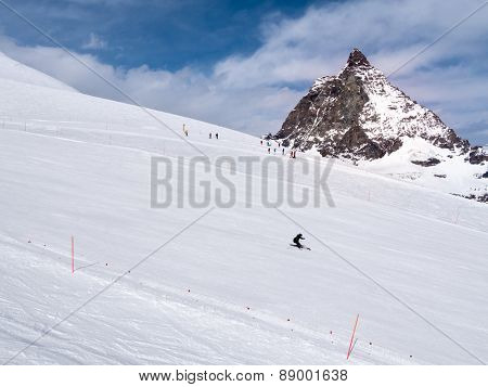 Ski slope in Zermatt ski resort - In background the famous Matterhorn peak. Western Alps, Zermatt, Switzerland, Europe.