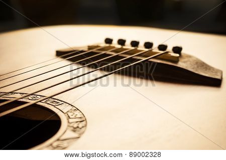Acoustic Guitar Focus On Bridge And Strings