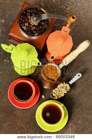 coffee beans and different utensils for boiling coffee (grinder, kettle, cezve)