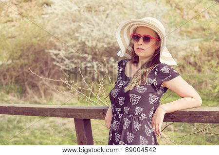 Cheerful Fashionable Woman In Stylish Hat, Frock And Sunglasses