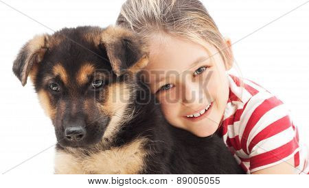 Little Girl Tenderly Embraces A  Puppy