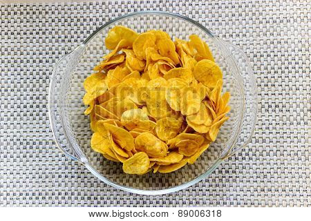 Indian savouries ~ raw fried banana chips kept on a glass bowl