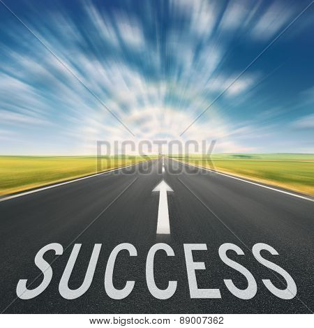 Empty Road At Sunset And Sign For Success In Blurred Motion