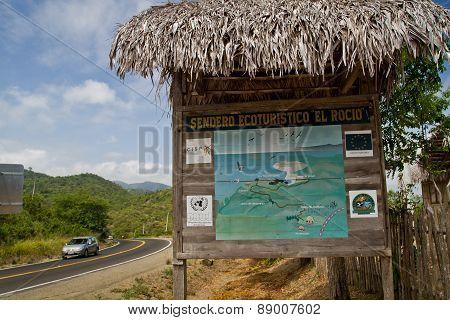 Road sign showing path of Machalilla National Park, Ecuador