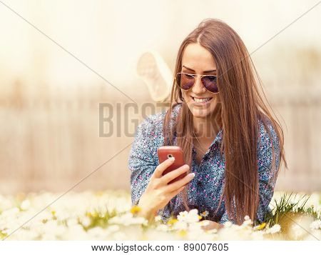 Young Teen Hipster Outdoor Using Cellphone