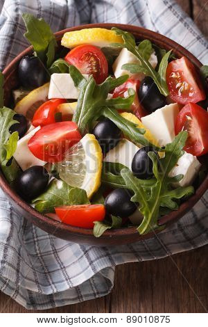 Salad Of Arugula, Feta, Olives And Tomatoes  Vertical Top View