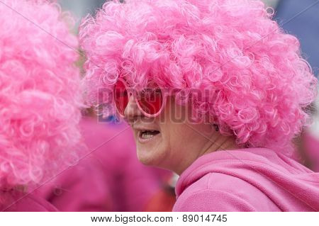 Woman in a pink wig.