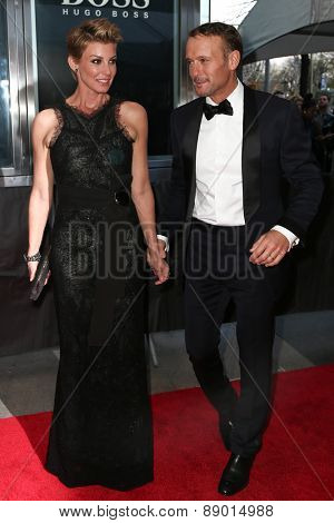 NEW YORK-APR 21: Recording artist Faith Hill (L) and husband Tim McGraw attend the 2015 Time 100 Gala at Frederick P. Rose Hall, Jazz at Lincoln Center on April 21, 2015 in New York City.