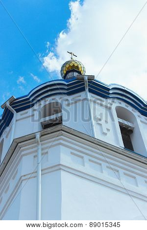 A Golden Dome With A Cross Of The Church