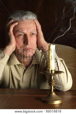 elderly man  in the dark