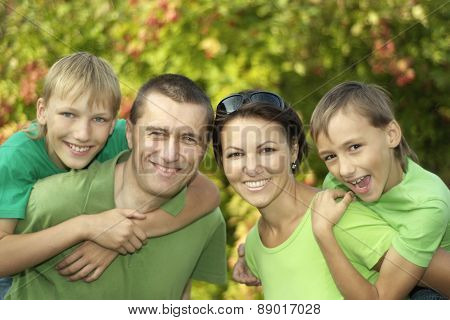 friendly family in green shirts