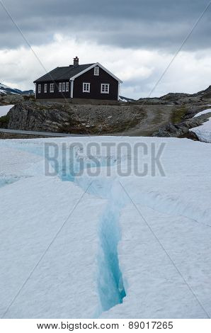 Lonely House In Snow And Ice Mountains