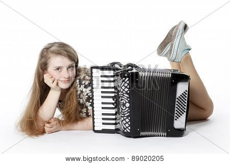 Teenage Girl On The Floor Of Studio With Accordion