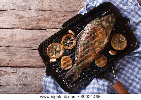 Grilled Carp With Lemon In A Grill Pan , Horizontal Top View