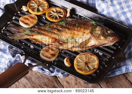 Grilled Fish Carp With Lemon  On A Frying Pan Grill, Horizontal