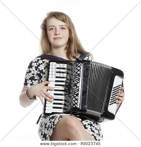 Teenage Girl Sits In Studio With Accordion