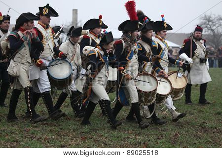 TVAROZNA, CZECH REPUBLIC - DECEMBER 3, 2011: Re-enactors uniformed as French military musicians attend the re-enactment of the Battle of Austerlitz (1805) near Tvarozna, Czech Republic.