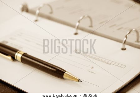 Cheque With Notebook