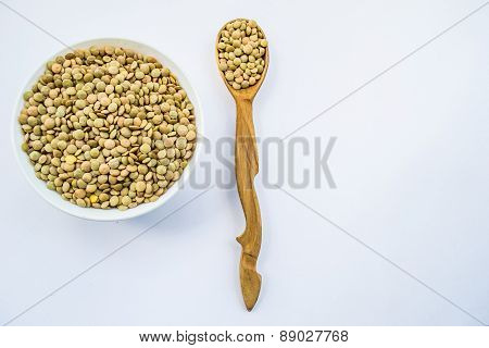 raw lentil, bob in bowl and wooden ladleful