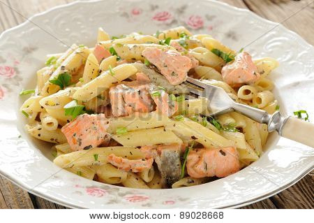 Creamy Pasta With Salmon And Parsley In White Plate