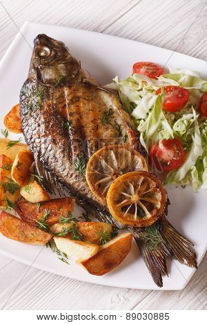 Grilled Fish With Fried Potatoes And Salad Vertical Top View