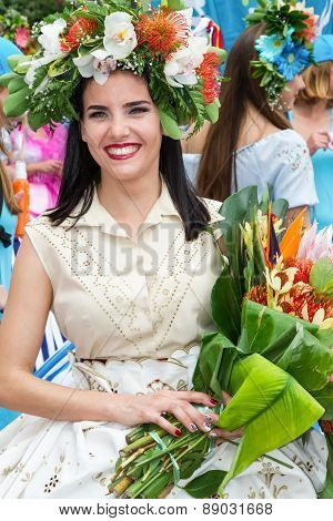 FUNCHAL MADEIRA - APRIL 20 2015: A beautiful young woman in the Madeira Flower Festival 2015.